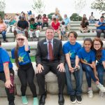 President and CEO of Texas Trust Credit Union pictured with students from Jones Academy in Arlington, TX