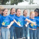 Children performing at the Jones Academy Outdoor Theater, sponsored by Texas Trust Credit Union