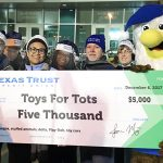 Texas Trust Credit Union presents $5000 check to Toys for Tots
