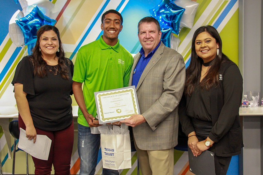 Dejardin Moffett was recognized for his accomplishments at the Texas Trust intern appreciation celebration. Pictured from left to right: Espy Taylor, DJ Moffett, Jim Minge, and Washima Huq.