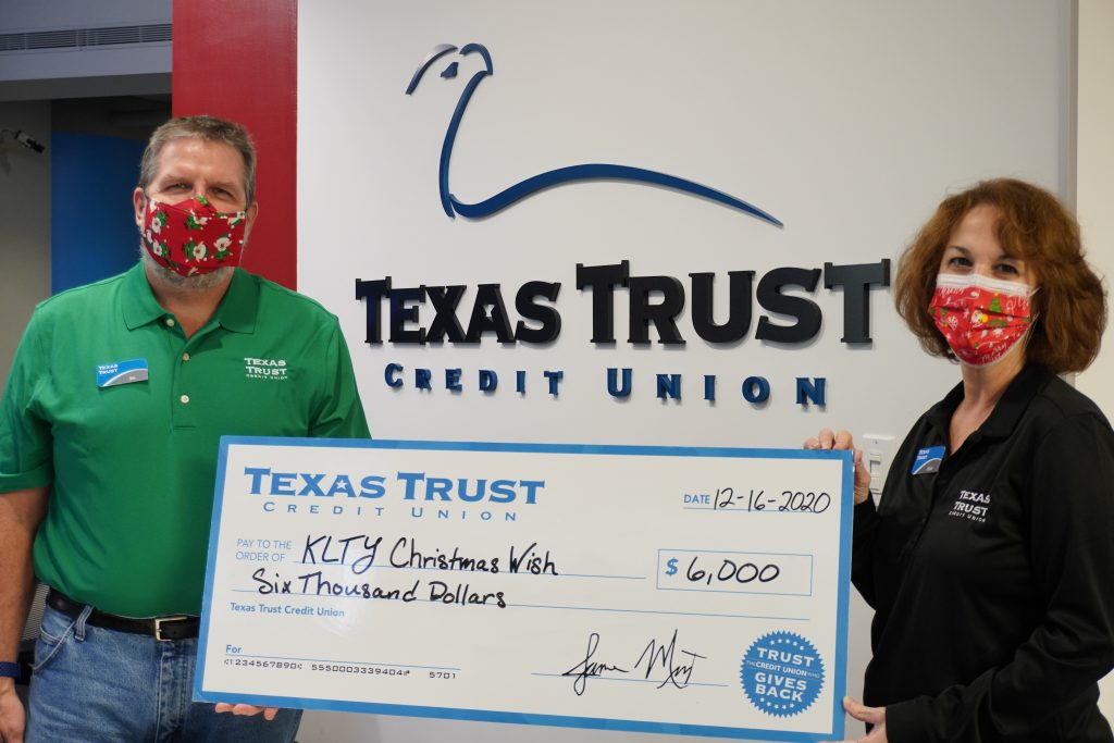 Jim Minge and Ginia Chapline of Texas Trust Credit Union and KLTY partner for Christmas Wishes