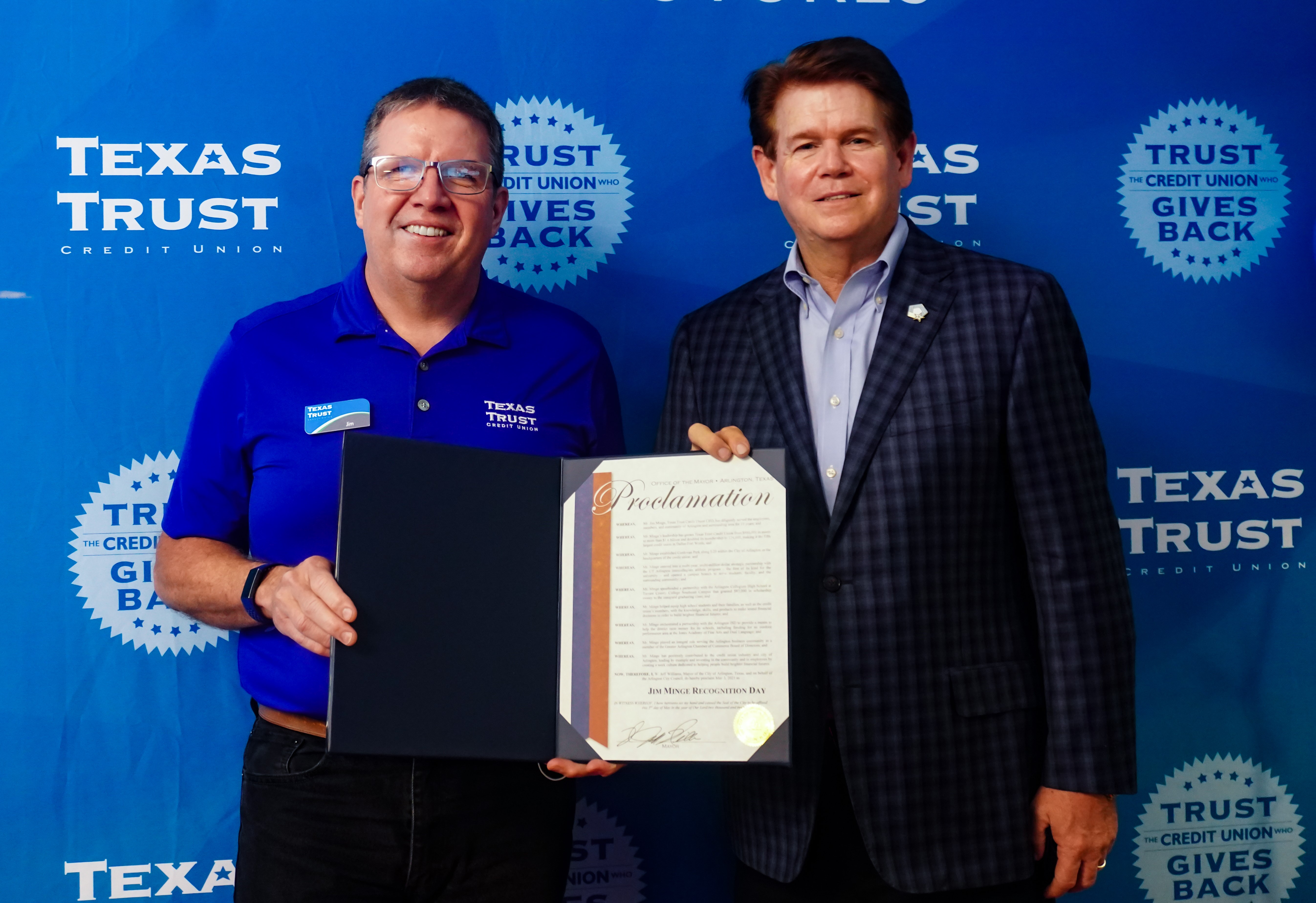 Texas Trust Credit Union CEO Jim Minge and Arlington mayor Jeff Williams at 'Jim Minge Recognition Day' Proclamation Ceremony