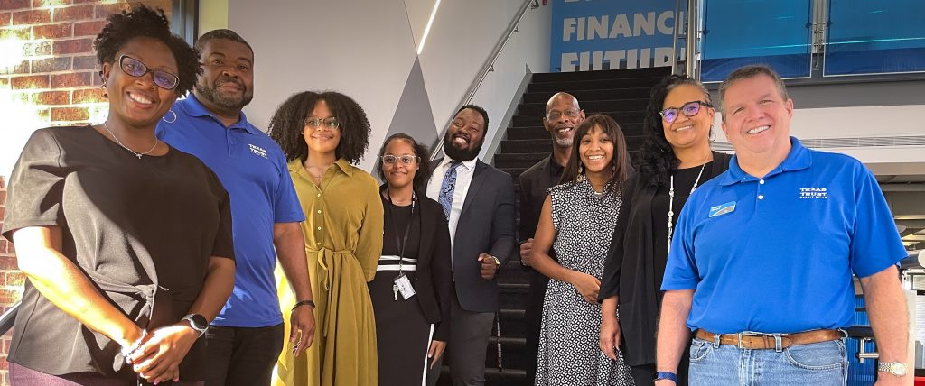 Paul Quinn College Scholar recipients pose with Texas Trust Credit Union staff. Pictured from left to right: From left to right Kizuwanda Grant, Ron Smith, Kayla Butler, Leah Butler, Ajai Washington, Maurice West, Mandy Brooks, Michelle Carter-Pope, and Jim Minge